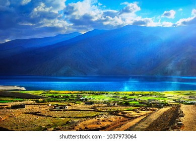 Beautiful scenic view - remote village Merak with traditional Tibetan houses near Pangong Tso lake at the background of mountain range and blue sky at morning, Ladakh, Jammu & Kashmir, Northern India