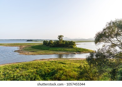 beautiful scenic view of river, green trees and clear blue sky, sri lanka, minneriya