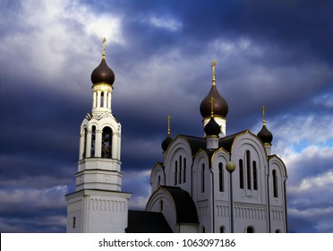 Beautiful scenic view - Russian Orthodox Church of St. Joseph Volotskiy at the background of dramatic stormy sky with dark clouds in Razvilka settlement, Moscow region, Russia