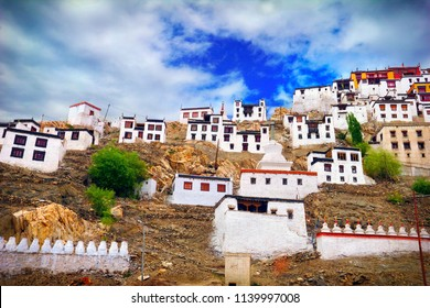 Beautiful scenic view: traditional Tibetan houses near Thiksey Buddhist Monastery (Gompa) against the background of blue sky - Leh district, Ladakh range, Himalayas, Jammu & Kashmir, Northern India