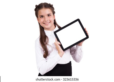 Beautiful school girl in a business suit holding a tablet in hand and with a smile looking at the camera. Selective focus on the tablet, with the depth of field Photo
