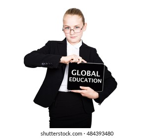 Beautiful school girl in a business suit holds a pc tablet in his hands and looking into the camera, on a pc tablet inscription global education