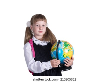 Beautiful schoolgirl sits at a school desk on a white background. School and  Education