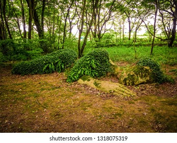 Beautiful sculpture in the forest - The Sleeping lady of Heligan - CORNWALL / ENGLAND - AUGUST 12, 2018