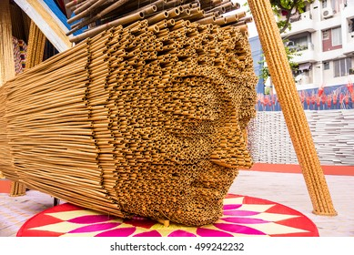 Beautiful sculpture of a human face with bamboo sticks kept at different lengths
