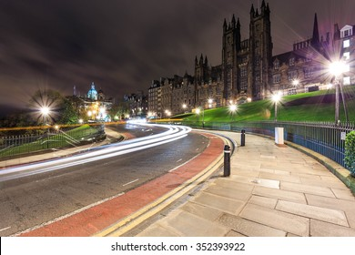 Beautiful s-curved light trail in foreground and beautiful Old Collage Building in background