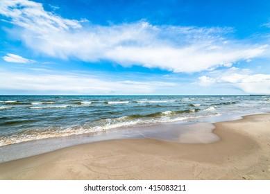 Beautiful sea beach landscape, coast with sea waves, tourist kurort - Leba, Baltic Sea, Poland