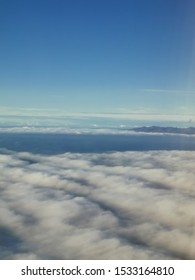 Beautiful sea of clouds view from aircraft window departed towards Scotland.