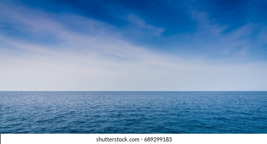 Beautiful sea Landscape with blue sky and tiny clouds on sunny day,Thailand.