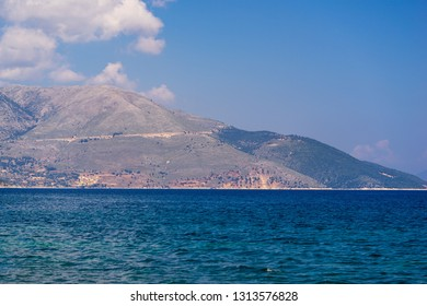 the beautiful sea landscape and the horizon with big hills or mountains against the background of the sky and are a lot of blank space