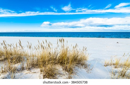 Beautiful sea landscape. Sandy beach and sand dune with grass, Leba, Baltic Sea, Poland