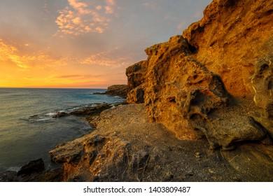 beautiful sea landscape - sunset over a rocky ocean cliff.Punta Papagayo, Lanzarote, Spain