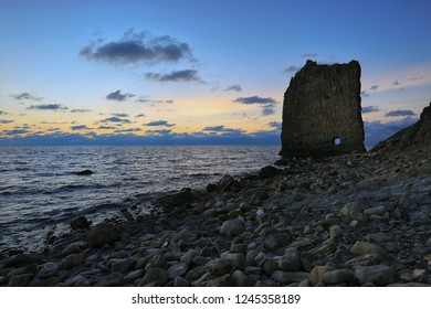Beautiful sea landscape at sunset with a view of the rock in the form of a sail on the coast of the Krasnodar Territory in Russia
