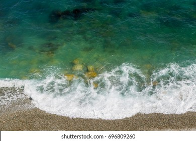 Beautiful sea or ocean pebble beach. Turquoise clear water. Scenic waterscape background