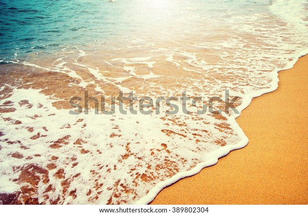 Beautiful sea summer abstract background. Golden sand beach with blue ocean waves Tourism and vacation concept. Beauty Backdrop