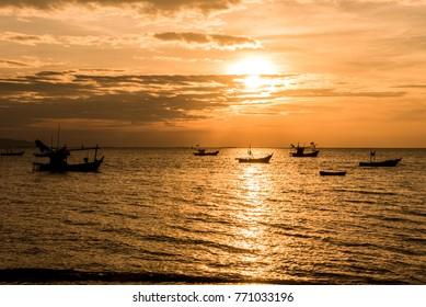 Beautiful sea sunset with fishing boats