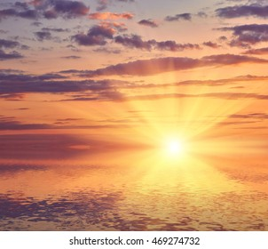 Beautiful sea sunset with sun rays