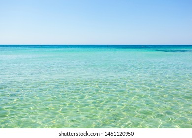 Beautiful sea with turquoise water and golden beach in Punta Prosciutto, Salento, Apulia, Italy.