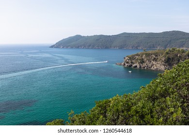 Beautiful sea view or the emerald sea of the island of Elba in Tuscany with a speedboat crossing the horizon. Elba island, Tuscany, Italy