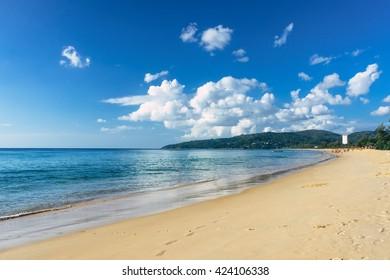 Beautiful sea view on Karon beach, Phuket, Thailand, Asia. Famous Karon beach landscape, Phuket. Sunny beach. Beautiful white sand sea shore and calm sea in Phuket, Thailand. Endless sandy coastline.