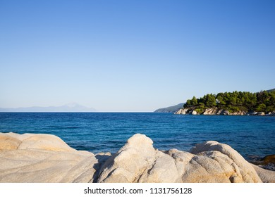 Beautiful sea view and rocks on a coast in Vourvourou beach, Halkidiki, Greece