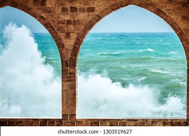 Beautiful sea view through amazing big arch windows of ancient building