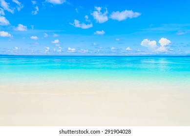Beautiful sea wave on the beach with blue sky background