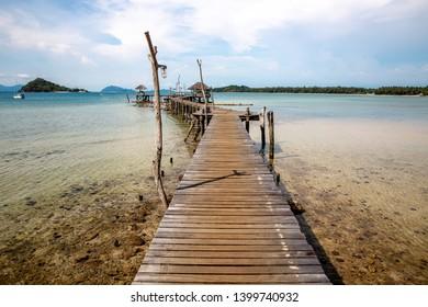 Beautiful sea with wooden pier at Ao Pra beach, Koh Mak Island, Trat, Thailand