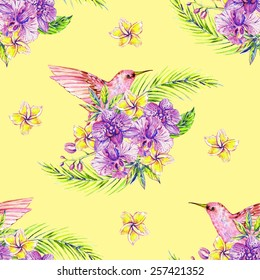 Beautiful seamless watercolor floral jungle pattern background. Hummingbirds, tropical flowers, palm leaves and plants, exotic print