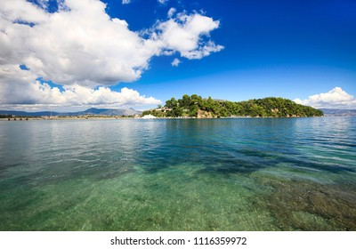 Beautiful seascape, blue sky with white clouds on the island of Corfu, Greece