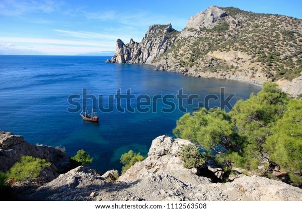 Beautiful seascape. Brigantine in the bay of the Black Sea off the coast of the Crimean coast