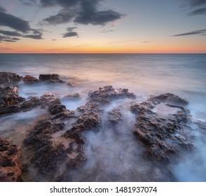 Beautiful seascape. Calm sea at sunset. Composition of nature.