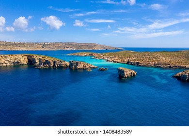 Beautiful seascape with clear blue water and sky. Malta islands. Stunning aerial view at Comino island coastline with caves and lagoons. Aerial view. From above. Summer tropical resort. Sea landscape.