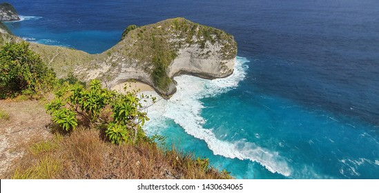 Beautiful seascape of Kelingking Beach on Nusa Penida Island, Bali, Indonesia with wave action and turquoise water