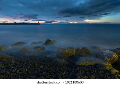 Beautiful seascape with lighthouse at sunset