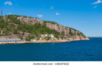 Beautiful seascape norwegian coastline, coast of Kristiansand with small lighthouse, Scandinavia, Norway. July 2019