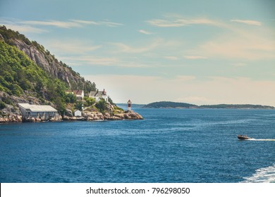 Beautiful seascape norwegian coastline, coast of Kristiansand with small lighthouse, Scandinavia Europe.