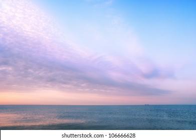 Beautiful seascape with orange warm sunrise, vacation concept