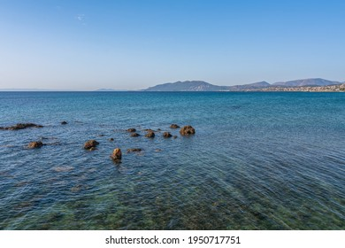 Beautiful seascape with rocks on the sea near the beach at Artemida, Athens, Greece. Greek seascape with rocky beach near Athens, Greece - Shutterstock ID 1950717751