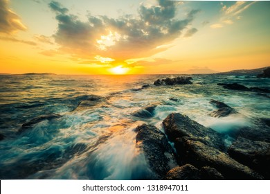 Beautiful seascape with rocks and waves at sunset