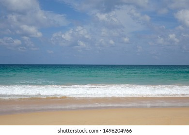 Beautiful seascape in summer season, beach sand, clear sea water,blue sky and white clouds. Copy space.