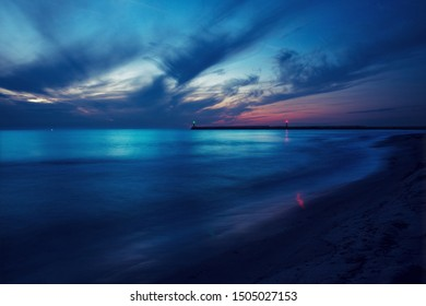 Beautiful seascape with two lighthouses at blue hour,  long exposure night shot