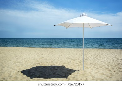 Beautiful seascape with an umbrella. A sea beach without people.