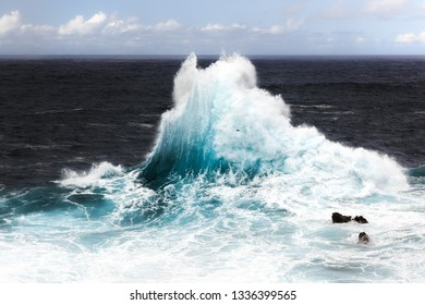 Beautiful seascape view of the big waves crashing at the shore at Porto Moniz, on the north coast of Madeira island