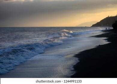 Beautiful seascape with a wave near the coast, the Black Sea coast at sunset in Crimea