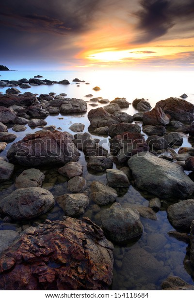 beautiful seascape of wave and rock and the sunset