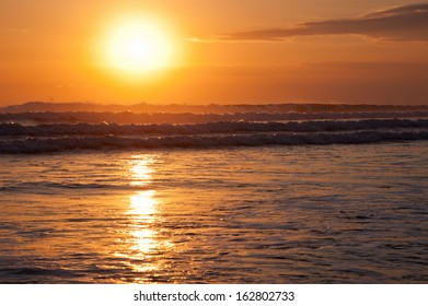 Beautiful seascape with waves at the sunset