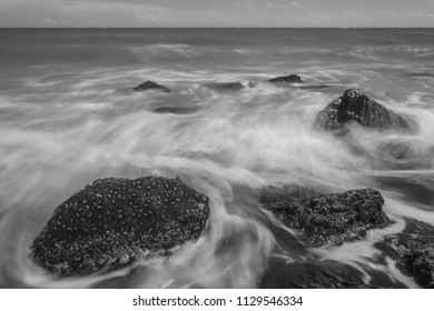 Beautiful seascapes with beach stones.Long exposure shot. Black and white.