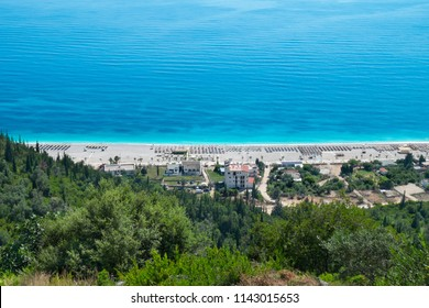 Beautiful seaside landscape from hill perspective in Albanian riviera. White stone beach, tortoise water in hot summer day