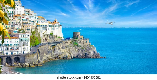 Beautiful seaside town Amalfi in province of Salerno, region of Campania, Italy. Amalfi coast is popular travel and holyday destination in Europe. Ripe yellow lemons in foreground.